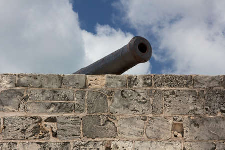 Cannon over the ramparts of Fort Montagu, historic fortification protecting the harbor of Nassau, Bahamas  photo