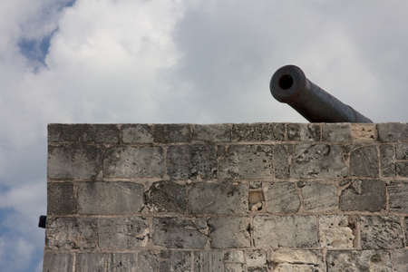 Historic cannon over the ramparts of Fort Montagu, Nassau, Bahamas  photo