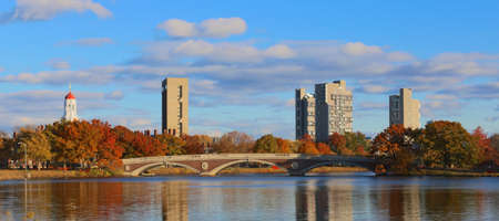 Weeks Bridge and dorm towers of Harvard University seen across the Charles in Cambridge, MA, USA on a beautiful fall day in November 2013