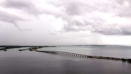 inclement weather: Bridge at Rickenbacker Causeway with the road to Key Biscayne from Brickell, Miami Stock Photo