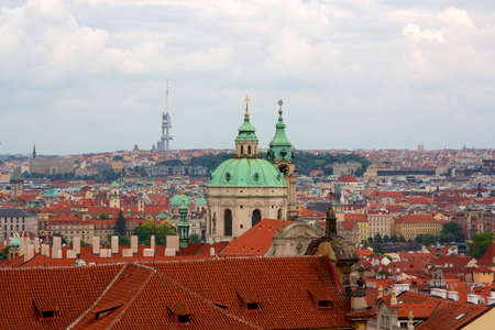 central european: Above the roofs of Prague, old Central European metropolis, modern tourist magnet, and capital of the Czech Republic  Stock Photo
