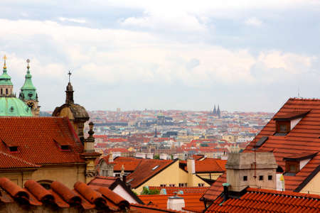 Above the roofs of Prague, old Central European metropolis, modern tourist magnet, and capital of the Czech Republic  Stock Photo