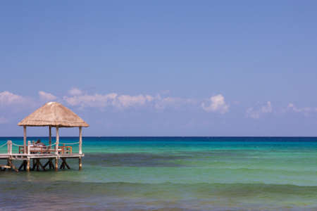 roo: Calm Caribbean waters stretch to the horizon in Playa del Carmen, Quintana Roo, Mexico