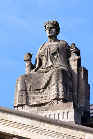 equitable: Justitia, Lady Justice, sitting on her throne above the portal of the Hanseatisches Oberlandesgericht  Supreme Hanseatic Court  of Hamburg, Germany  Stock Photo