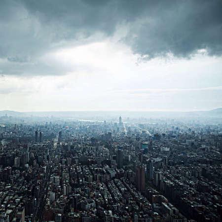 urban sprawl: Aerial view of Taipei, Taiwan under ominous clouds. Stock Photo