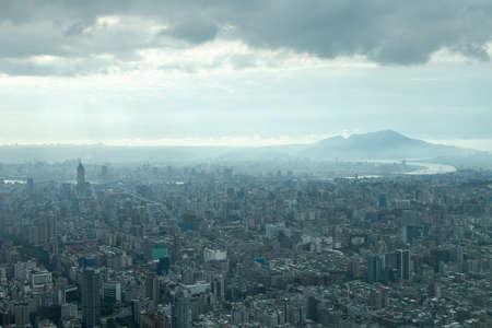 urban sprawl: Aerial view of Taipei, Taiwan under a cloudy sky