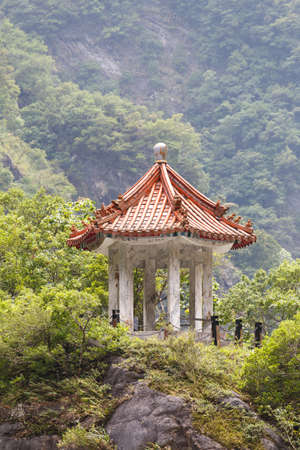 pavillion: Small traditional Chinese pavillion perched atop a cliff in the mountains of Taroko National Park, Taiwan  Stock Photo