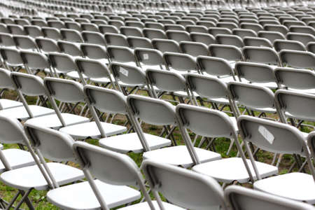 Row upon row of empty chairs waiting for the audience at a university graduation ceremony  photo
