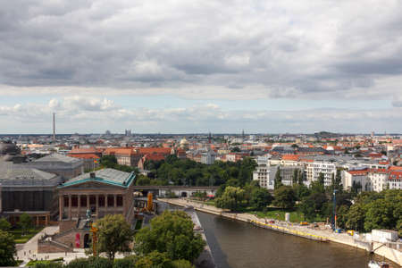 sprawl: Aerial view across cityscape past museum island and the river Spree in Berlin-Mitte, Berlin, Germany