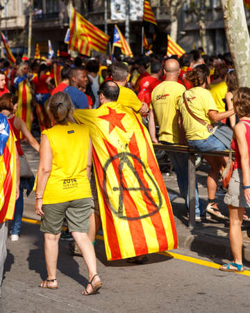 Barcelona, Spain - September 11, 2014: People call for Catalan independence on the 300th Catalan National Day in the streets of Barcelona, Spain on September 11, 2014.