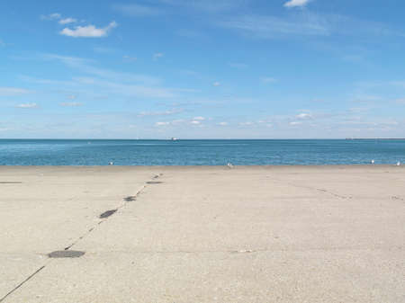 View of vast Lake Michigan from the Gold Coast area in Chicago, IL, USA, on a sunny day in fall 2014. photo