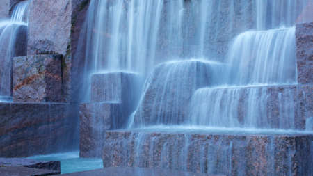 Water streams down man-made rock formations at Franklin Delano Roosevelt Memorial in Washington DC, USA.