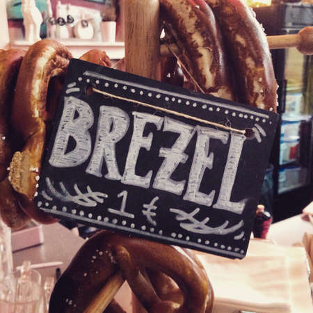 advertised: Sign advertised pretzels at a bar in Berlin, Germany.
