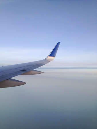 high flier: View from a jetliner of its right wing over creamy smooth clouds.