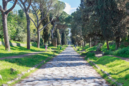 View down the ancient Via Appia Antica in Rome, Italy. Stock Photo