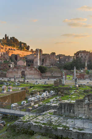 destination scenics: The ancient ruins of the Forum Romanum in Rome, Italy at dusk. Stock Photo
