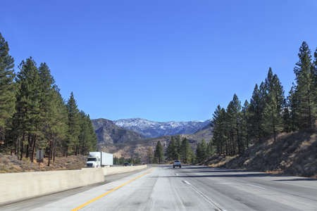 range of motion: First person view of a drive along a mountain highway in the Californian Sierra Nevada. Stock Photo