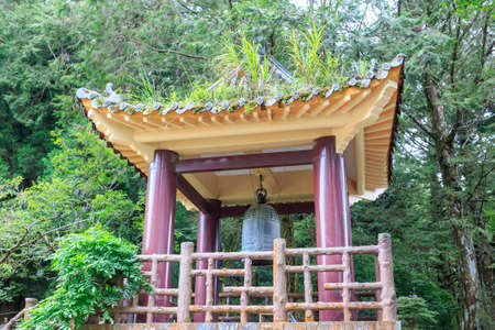 pavillion: Bell pavillion at a buddhist shrine in the mountain forests of Alishan Taiwan.
