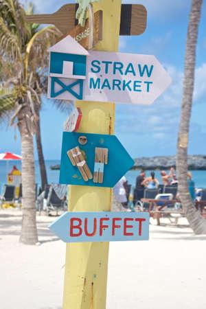 caribbean island: Signpost on a Caribbean island beach in the Bahamas. Stock Photo