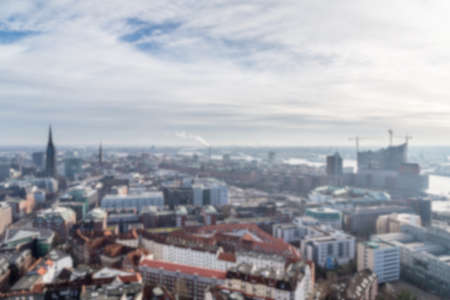 urban sprawl: Blurred background of view over the Neustadt area towards the HafenCity and the Elbphilharmonie in the distance in Hamburg, Germany. Editorial
