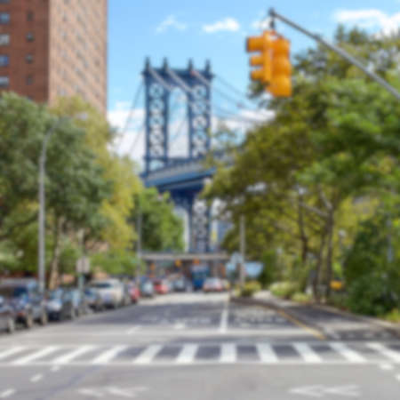 lower east side: Blurred background of the view down Pike Street at the Manhattan Bridge in the Lower East Side, New York, NY, USA.