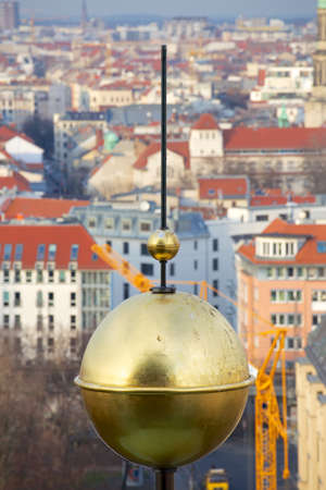 golden globe: View of the Berlin cityscape past a golden globe on the roof of the Berlin cathedral.