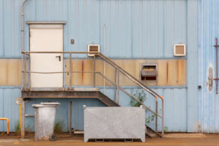 the facility: Blurred background of building detail at an old industrial facility. Stock Photo