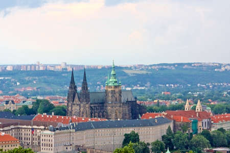 central european: Above the roofs of Prague, old Central European metropolis, modern tourist magnet, and capital of the Czech Republic.
