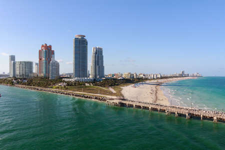 continuum: View of condo towers and the beach at South Beach, FL, USA.