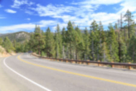 Blurred background of a mountain highway at Tahoe National Forest, California, USA. Stock Photo