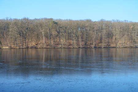 no snow: Frozen lake Schlachtensee in Berlin on a snowless winter day.