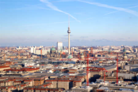 tv tower: Blurred background of the Berlin-Mitte cityscape with the landmark Fernsehturm (tv tower) in the center. Stock Photo