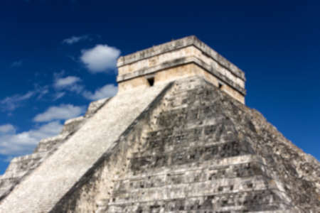 feathered: Blurred background of Mayan Pyramid to Kukulkan, the feathered serpent god, at Chichen Itza, Yucatan, Mexico.