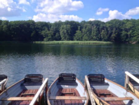 rowboats: Blurred background of rowboats at a forest lake in summer.