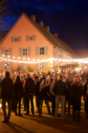 weihnachtsmarkt: Background blur of German christmas market at night. Stock Photo