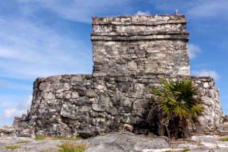 destination scenics: Blurred background of Mayan ruins at the archeological site of Tulum, Quintana Roo, Mexico.