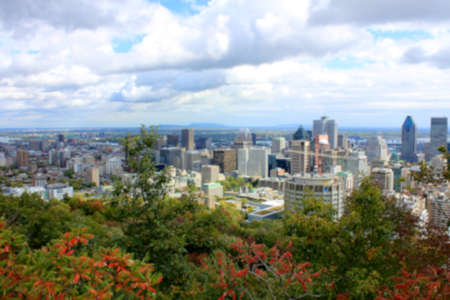 urban sprawl: Blurred background of view of Montreal, Quebec from Parc du Mont-Royal. Stock Photo