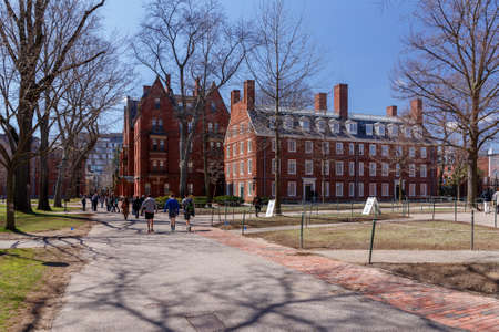 CAMBRIDGE, MA, USA - APRIL 9, 2016: Life in Harvard Yard, historic heart of the campus of Harvard University, in Spring in Cambridge, MA, USA on April 9, 2016.