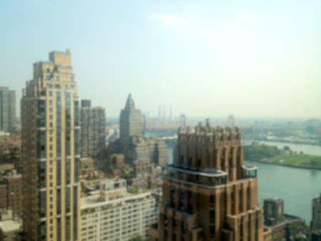 urban sprawl: Blurred background of view towards the Queensboro Bridge from East Midtown Manhattan in New York, NY, USA.
