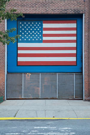 American flag painted on a shutter over a driveway in New York, NY, USA. Stock Photo