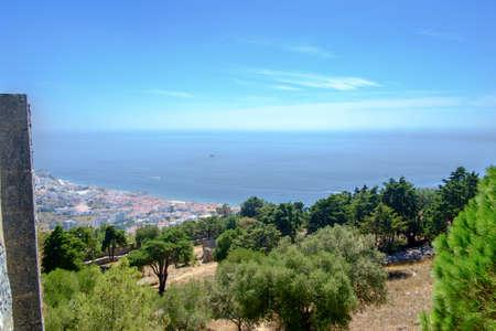 View down from the Moorish caste above Sesimbra towards the Portuguese coastal town. Stock Photo