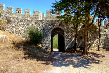 View of medieval wall and gate at the Moorish Castle above Sesimbra, Portugal.