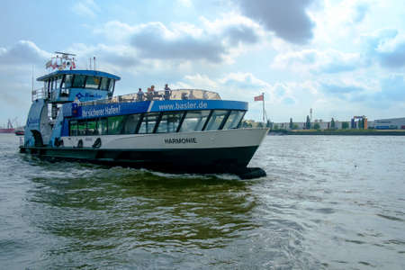 HAMBURG, GERMANY - SEPTEMBER 2016: Harbor ferry passing by on the Elbe River in Hamburg, Germany in September 2016.