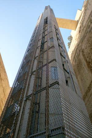 Modern Barrakka Lift built into historic walls below Upper Barrakka Gardens in Valletta, Malta.