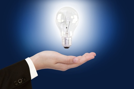 women hand with Light bulb Stock Photo - 10948885