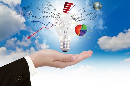 business efficiency: Light bulb in hand with graph out