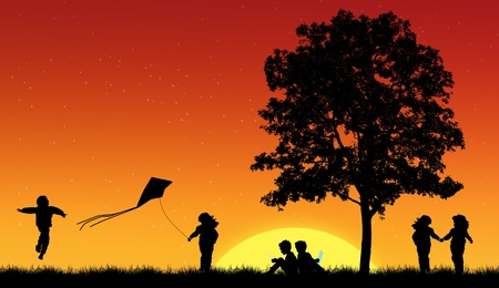 Silhouettes of children playing in grass with tree photo
