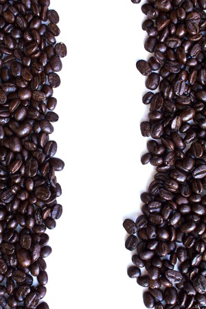 Close up of coffee beans on white background  photo