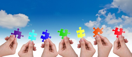 Hands and puzzle photo