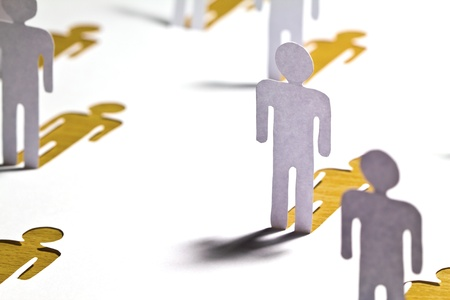 Social Network concept : close up of people cut out of paper on wooden table Stock Photo
